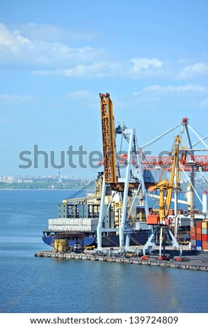 Container stack and ship under crane bridge