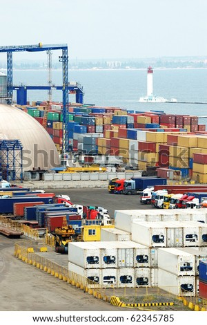 Container terminal and lighthouse - stock photo