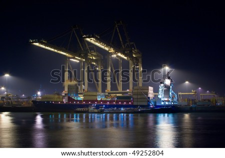 Container terminal at night - stock photo