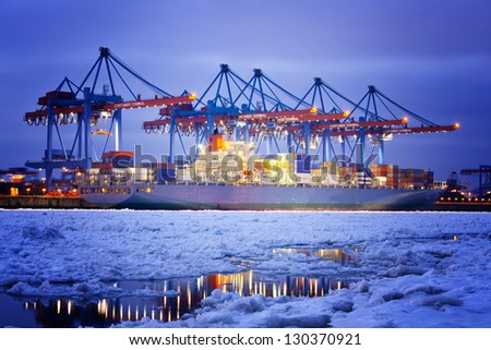 Container Terminal in Hamburg during winter. - stock photo