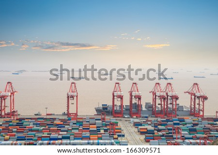 container terminal with sunset glow in shanghai east China sea  - stock photo