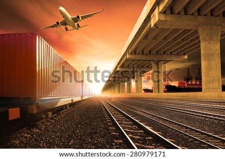 container trains on railways track cargo plane flying above for land transport and cargo air freight business - stock photo