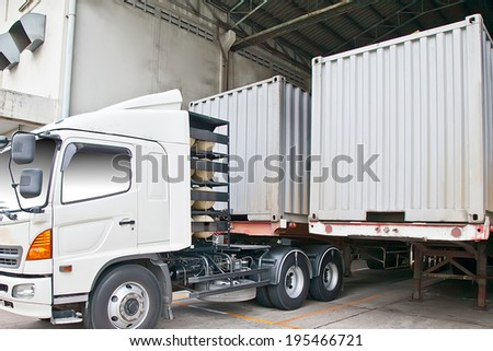 Container truck at warehouse building - stock photo