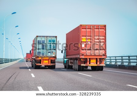 container trucks on the bridge, modern intermodal logistics background - stock photo