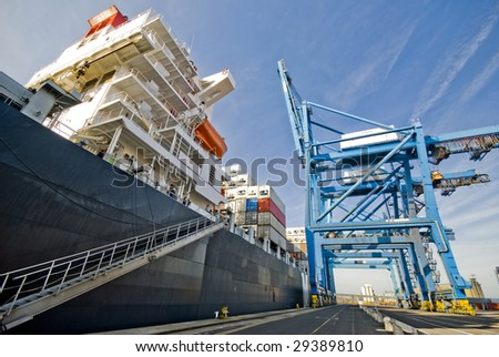 container vessel moored in the port, this photo does not contain logos - stock photo