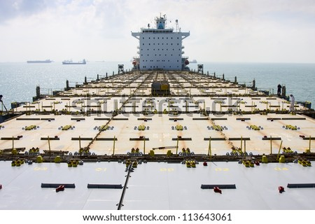 Container vessel. View on empty deck. - stock photo