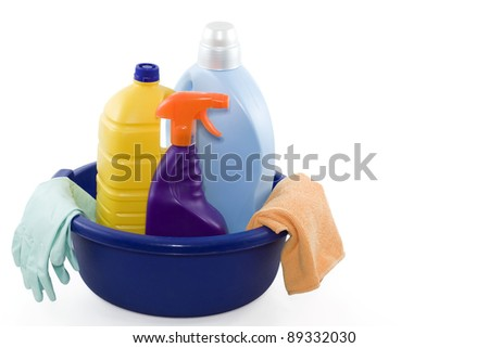 container with three cleaning products, gloves and cloth - stock photo