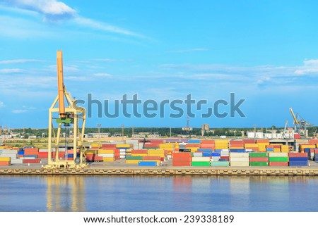 Containers and crane in cargo port - stock photo