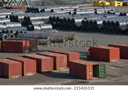 Containers and metal at sea trading port - stock photo