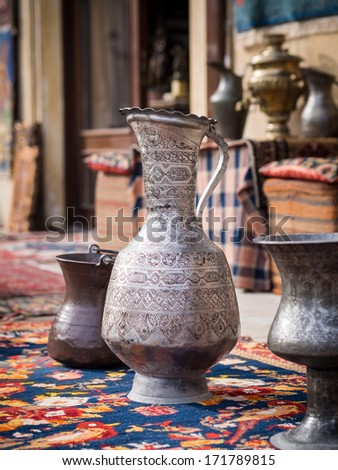 Containers and other souvenirs sold on a local market in the old town of Baku (Icheri Sheher), Azerbaijan. - stock photo