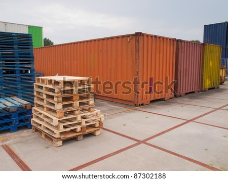 containers and pallets waiting on a  trading site - stock photo