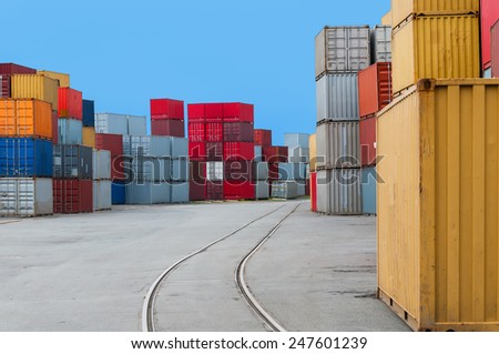 Containers and Railtracks in a port - stock photo