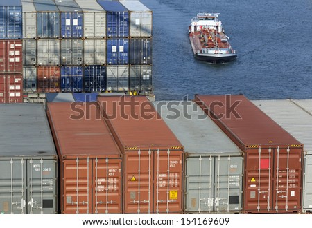 Containers and tanker ship in the harbor of Rotterdam, Netherlands - stock photo