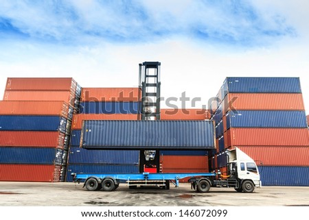 Containers at the Docks with Truck - stock photo