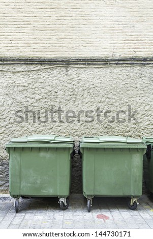 Containers facade green building, cleaning and recycling in city - stock photo