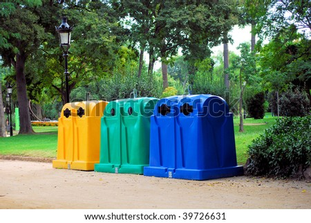 containers for assemblage and recycling  waste and dust in a botanical garden park of Barcelona - stock photo
