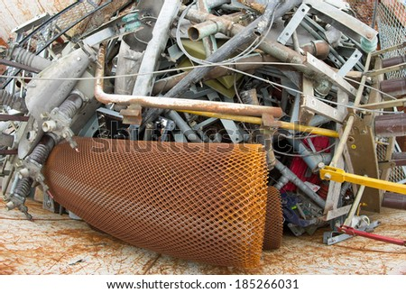 containers full of rusted iron pieces ready to be used in a foundry - stock photo