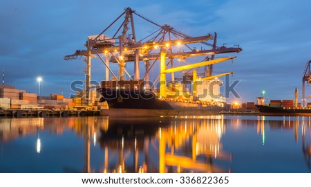 Containers loading by crane at dark sunset, Shipping Trade Port - stock photo