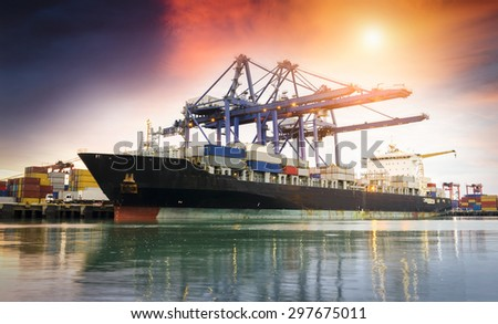 Containers loading by crane at dark , Trade Port , Shipping - stock photo
