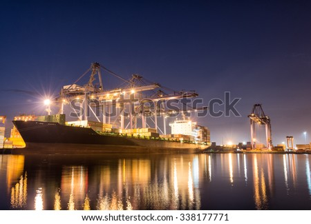 Containers loading by crane on morning dark, Trade Port , Shipping , transport - stock photo