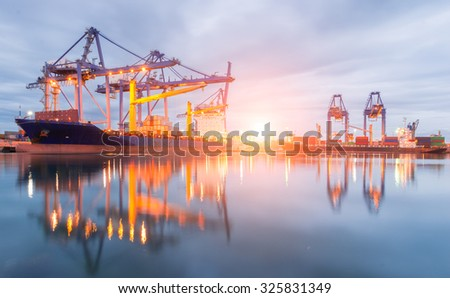 Containers loading Shipping by crane at morning or Trade Port - stock photo