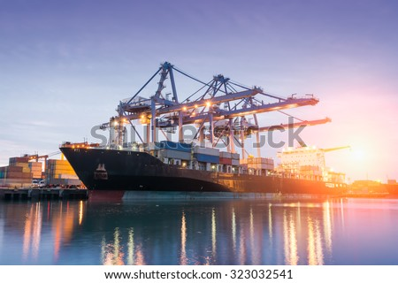 Containers loading with crane or trade Port at sunrise - stock photo