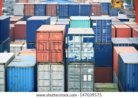 Containers stacked on the dock - stock photo