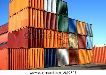 Containers waiting to be loaded in an intermodal yard - stock photo