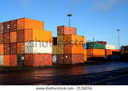 Containers waiting to be loaded in an intermodal yard 5 - stock photo