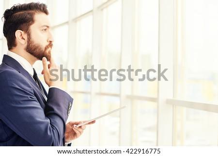 contemplating businessman - stock photo