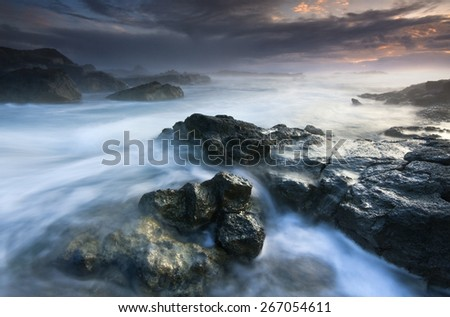 Contemplation Ocean Sunset Landscape In South Iceland/ Rocky Beach Sunset - stock photo