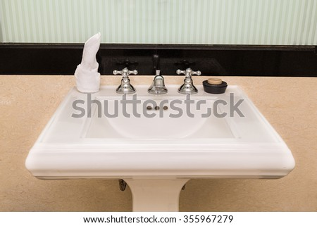 Contemporary and elegant wash basin sink in toilet bathroom