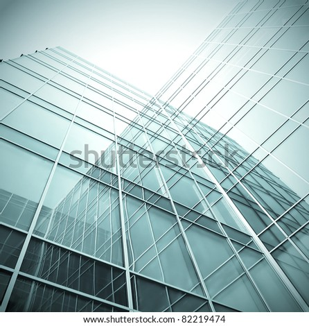 contemporary angle of glassy business building - stock photo