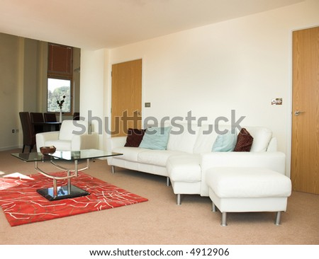 Contemporary apartment living space. Property released. Artwork removed from walls.
