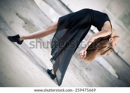 Contemporary ballet dance performance in a urban scene - stock photo