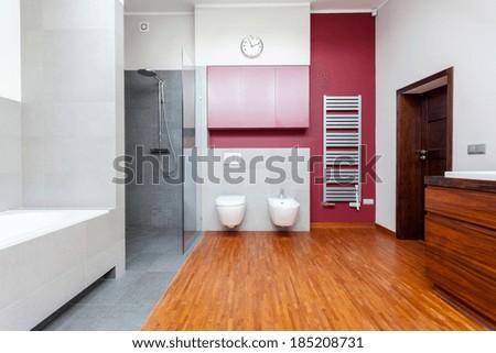 Contemporary bathroom interior with bath and shower - stock photo