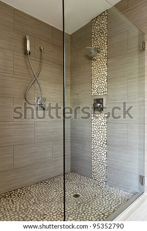 Contemporary Bathroom Shower with Dual Shower Heads and Glass Enclosure.