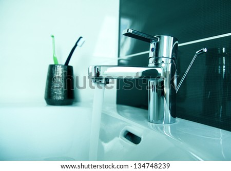 contemporary bathroom tap detail - stock photo
