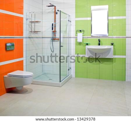 Contemporary bathroom with green and orange ceramics - stock photo