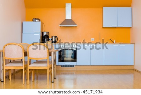Contemporary blue kitchen with silver coffee maker - stock photo