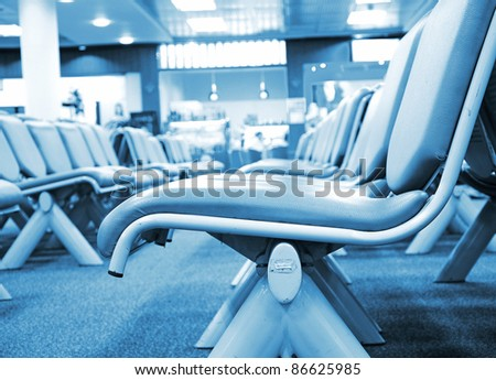 contemporary blue lounge with empty seats in airport - stock photo