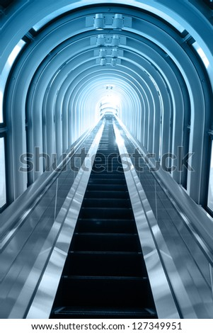 Contemporary blue moving escalator - stock photo