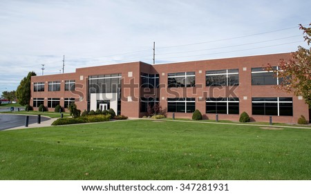 Contemporary Brick Business Building with Lawn - stock photo