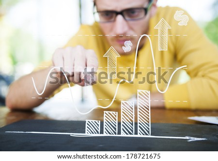 Contemporary Businessman Studying a Graph - stock photo