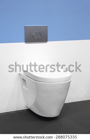 Contemporary Ceramic Toilet Seat in Bathroom - stock photo