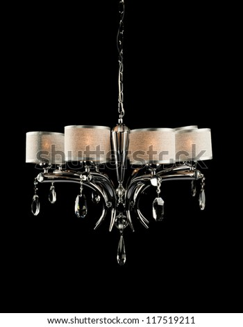 Contemporary chandelier with crystals isolated over black background - stock photo