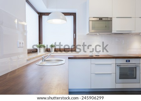 Contemporary clean kitchen with wooden wheat - stock photo