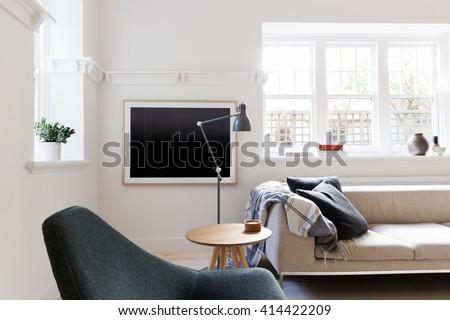 Contemporary Danish styled living room in art deco Australian apartment - stock photo