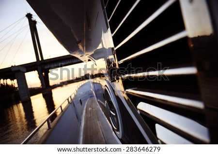contemporary deck motor yacht. sunset - stock photo