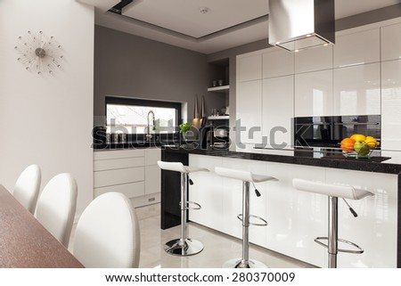 Contemporary decor of new kitchen in expensive house - stock photo
